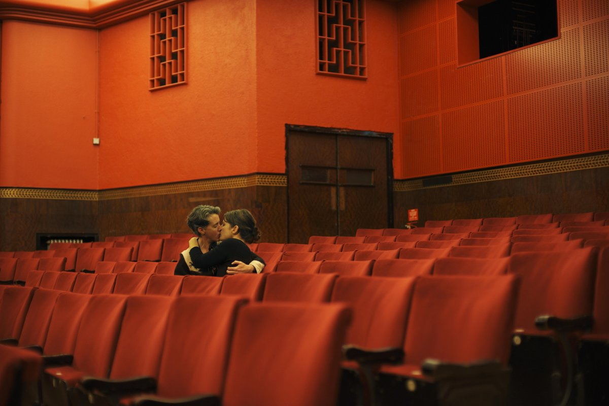 Couple kissing in an empty theatre