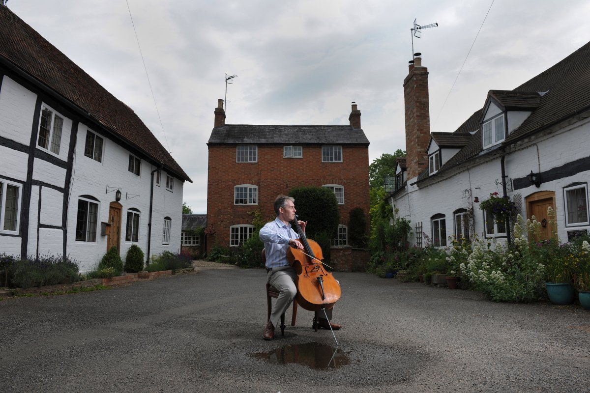 David Thomson plays the cello that was handed down to him from his mother and through which he met his wife Alison