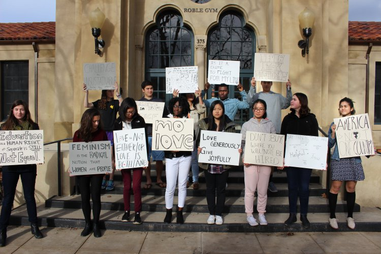 A group of activists holding signs