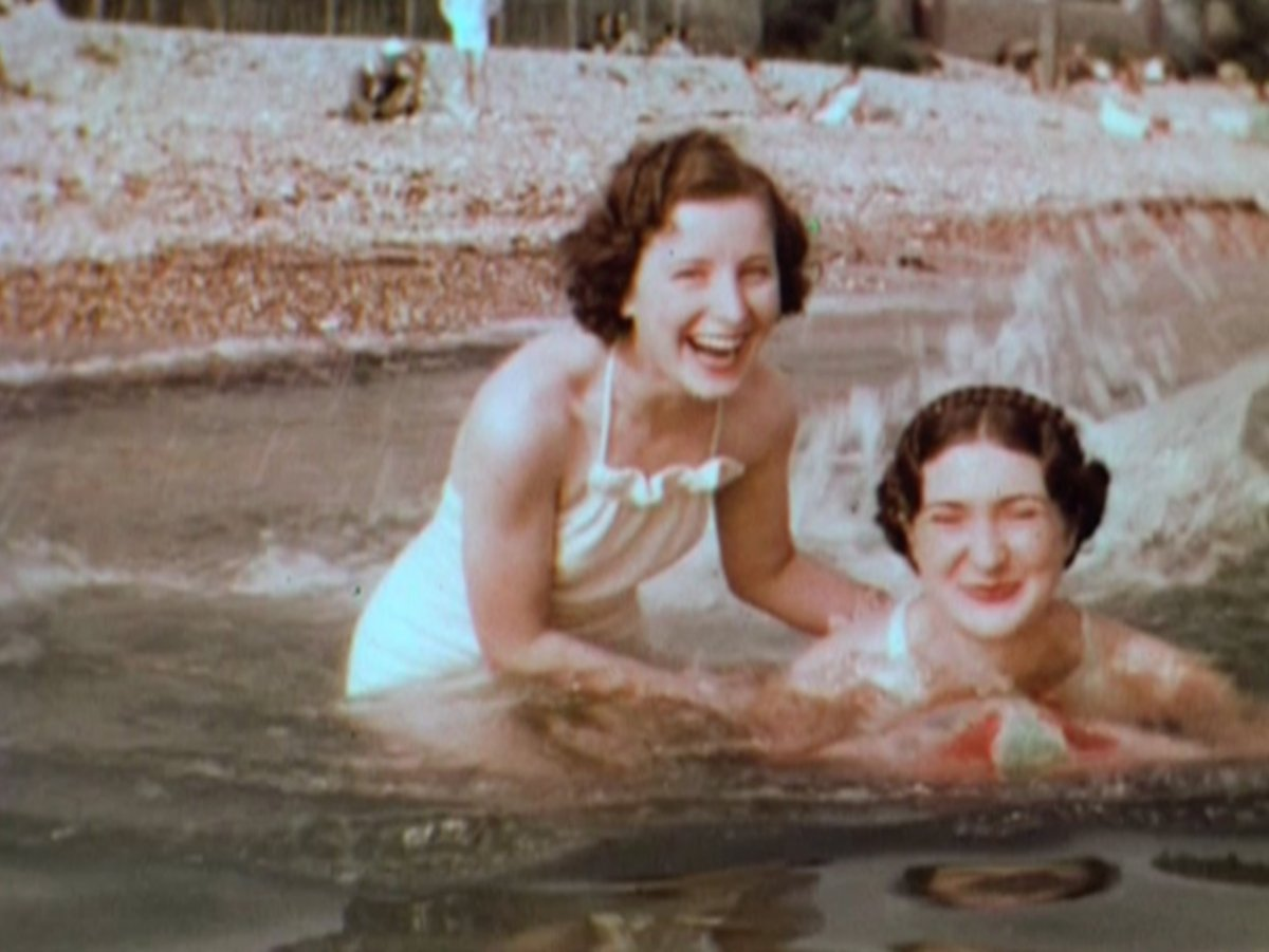 1960's photo of two women in the sea